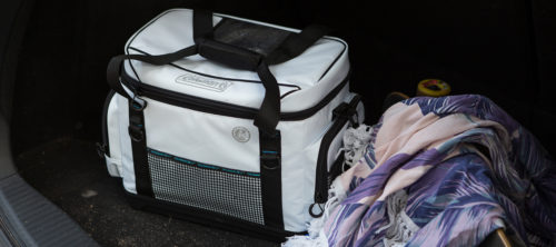 Coleman 36-hour marine cooler in trunk of car with blankets
