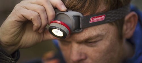Man with Coleman Battery Guard Headlamp on