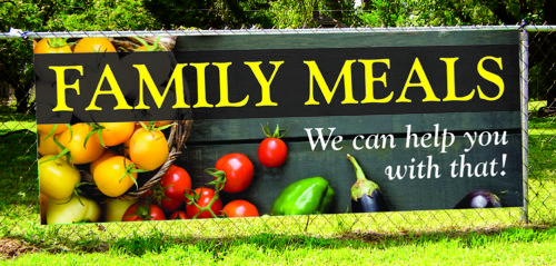 Banner on fence advertising family meals available