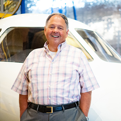 Marc Seiwert, Sales Associate leaning on plane bulk head at Exploration Place in Wichita, KS