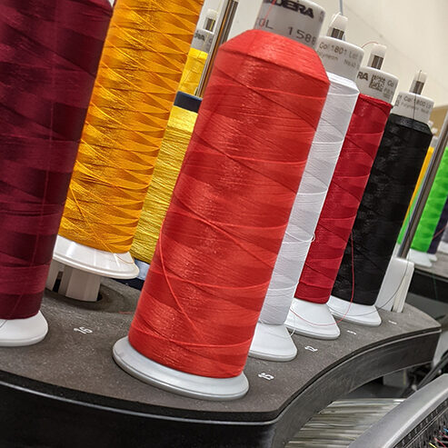 embroidery floss in multiple colors on embroidery machine
